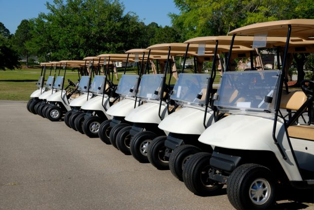 Electric Golf Carts Buggies at Golf Course standing ready for golfers