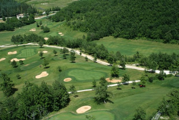golf course with sand bunkers, trees, rough and water hazards